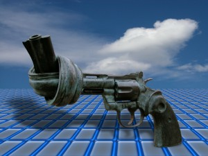 Concept image of a gun with the barrel tied in a knot against the backdrop of a grid.