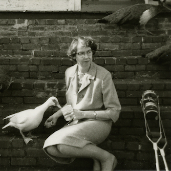 Flannery OConnor with Duck and crutches on steps